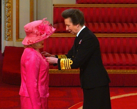 Friends of the Animals Helen Sinclair receiving her MBE from HRH The Princess Anne